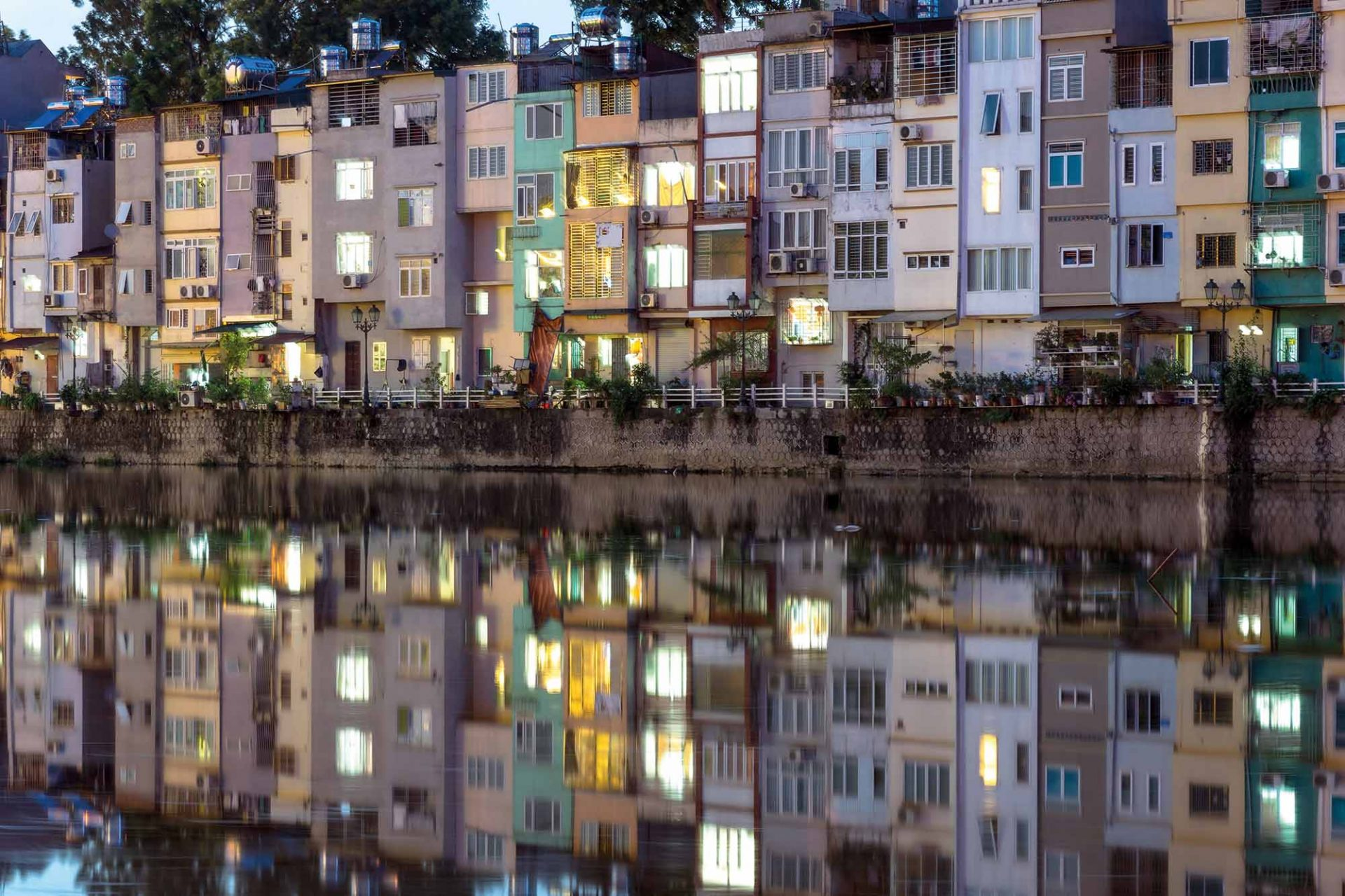 Resident Houses With Reflection On Lake In Hanoi, Vietnam